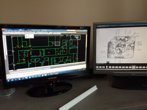 Dual CAD monitor setup for efficiency.
